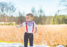 the-boy-box-suspenders-heart-valentine-bib-xo